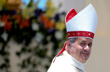 FILE PHOTO: Bishop Juan Barros looks on as Pope Francis leaves at the end of a mass at the Lobito beach in Iquique, Chile January 18, 2018. Picture taken January 18, 2018  REUTERS/Alessandro Bianchi/File Photo