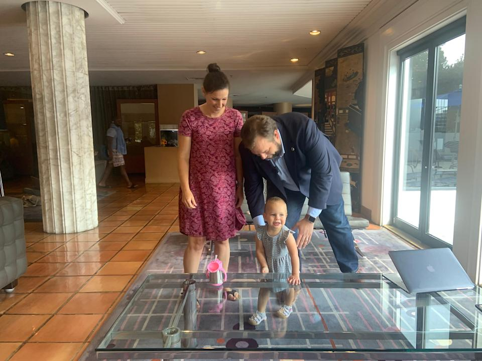 State Rep. John Bucy III, D-Austin, stands in the lobby of the Washington Plaza Hotel with his daughter, Bradley, and wife, Molly, on July 16. The Bucy family drove from Austin and joined nearly 60 House Democrats who flew to Washington to break quorum and block passage of a GOP voting bill.