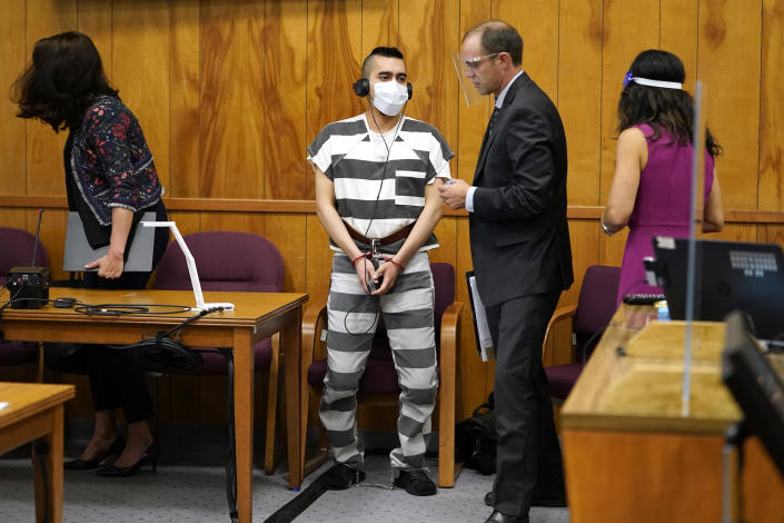 Cristhian Bahena Rivera, center, prepares to leave the courtroom after his sentencing, Monday, Aug. 30, 2021, at the Poweshiek County Courthouse in Montezuma, Iowa. Rivera was sentenced to life in prison for the stabbing death of college student Mollie Tibbetts, who was abducted as she was out for a run near her small eastern Iowa hometown in July of 2018. (AP Photo/Charlie Neibergall, pool)
