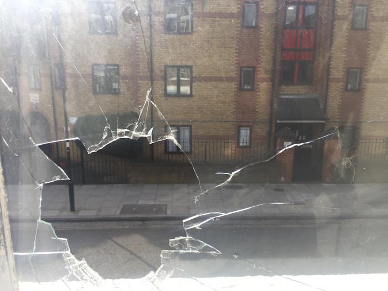 Photographs supplied by Ms Diego purportedly showing a smashed window from inside the gallery: Lucia Diego