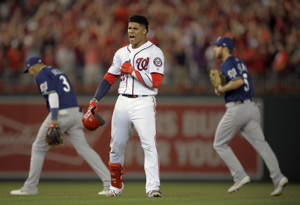 WASHINGTON, DC - OCTOBER 1: Washington Nationals left fielder Juan Soto (22) celebrates his game winning hit after getting tagged out for the 3rd out in the 8th inning  during the Washington Nationals defeat of  the Milwaukee Brewers 4-3 to win the wild card at Nationals Stadium in Washington, DC on October 1, 2019 . (Photo by John McDonnell/The Washington Post via Getty Images)
