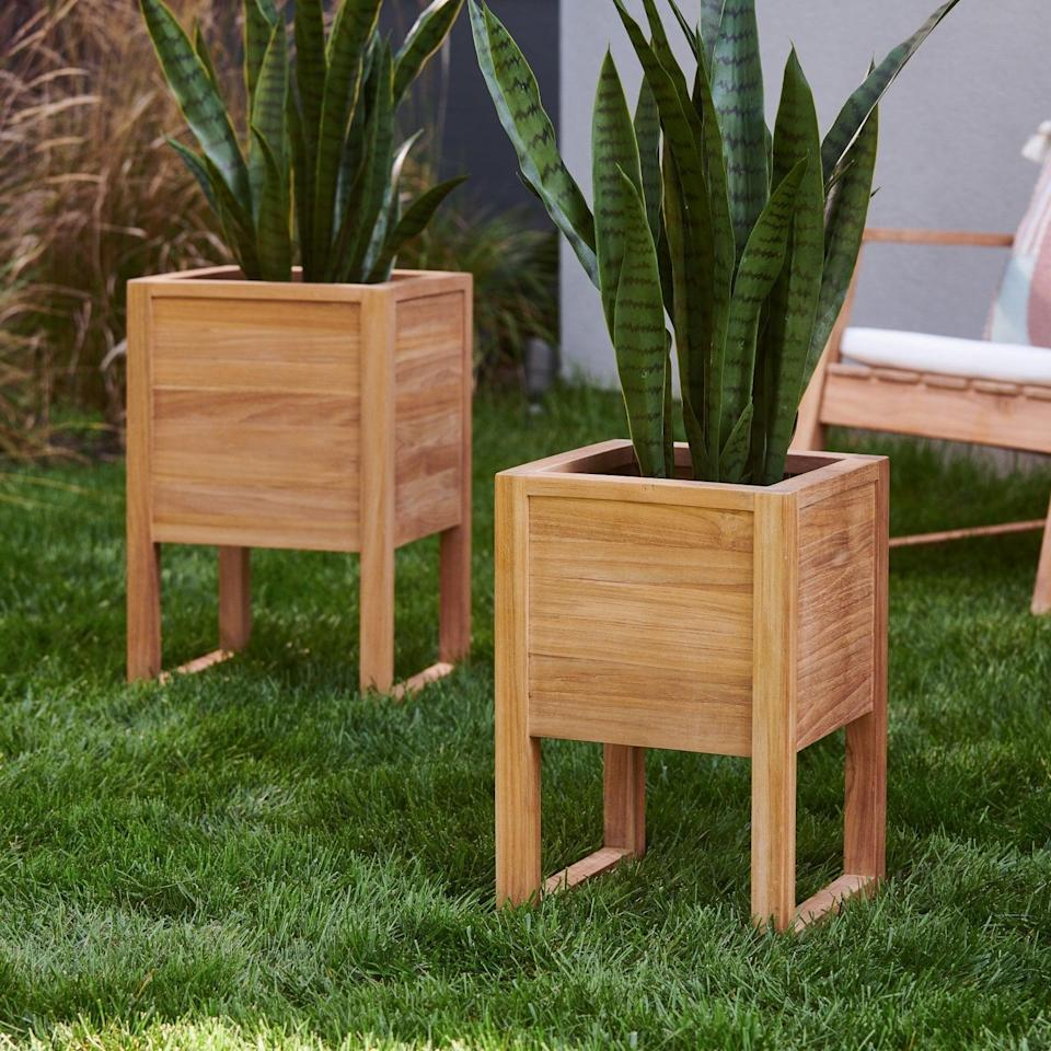 <p>Cover your backyard with plants in this gorgeous <span>MoDRN Elevated Teak Planter</span> ($100-$150).</p>