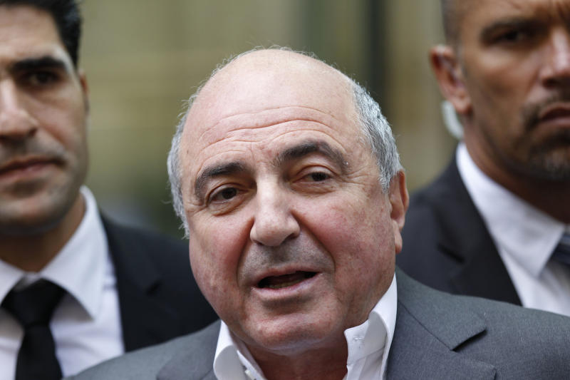 FILE - A  Friday, Aug. 31, 2012 photo from files showing Russian tycoon Boris Berezovsky talking to the media after losing his case against Russian oligarch Roman Abramovich as he leaves the High Court in London. United Kingdom police have said that Berezovsky has been found dead Saturday March 23, 2013.(AP Photo/Sang Tan, File)