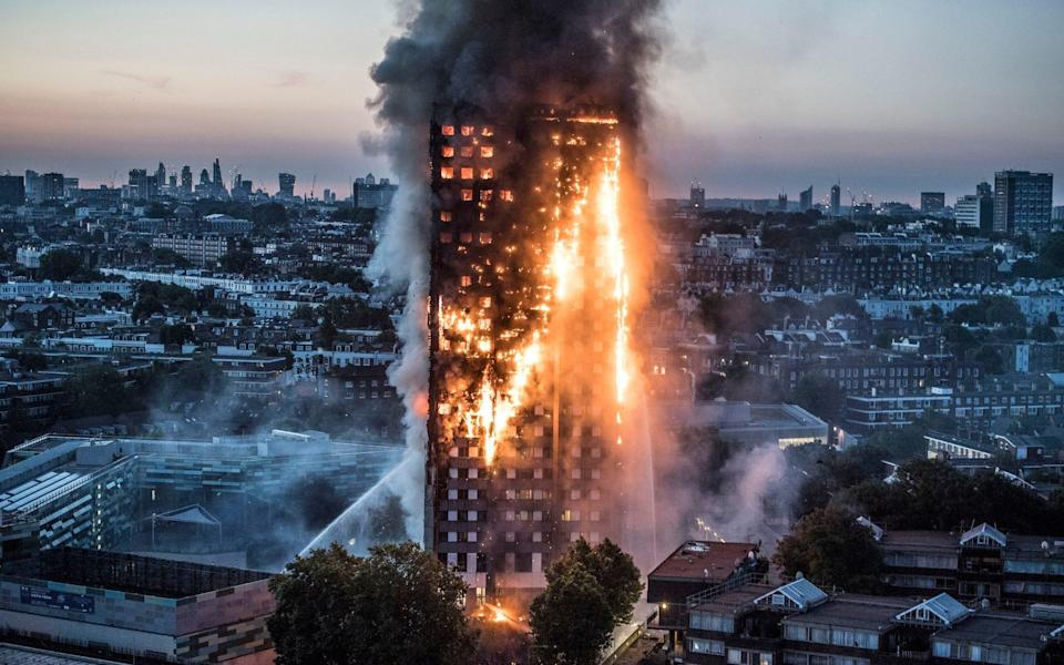 Huge plumes of smoke pour from Grenfell Tower as the blaze rages - Credit: JEREMY SELWYN/Eyevine