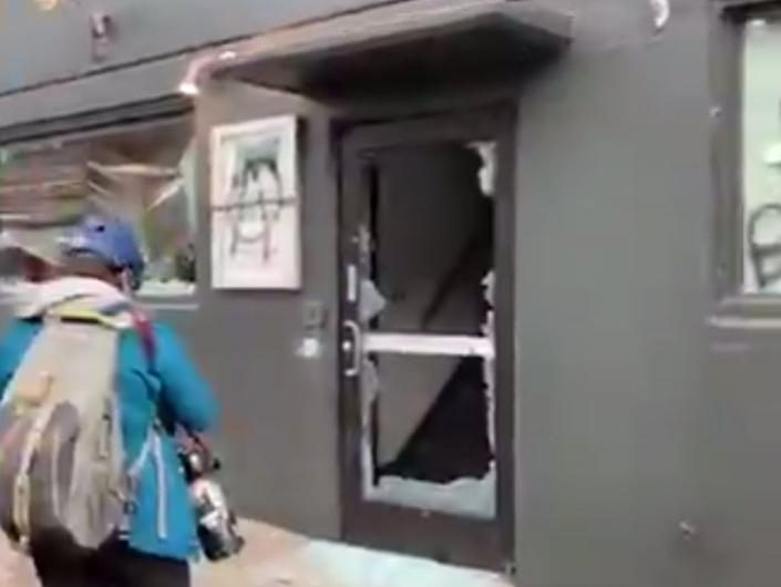 <p>Protesters damage the Democratic Party office building in Portland, Oregon, on Wednesday</p> (Mike Benner / KGW News)