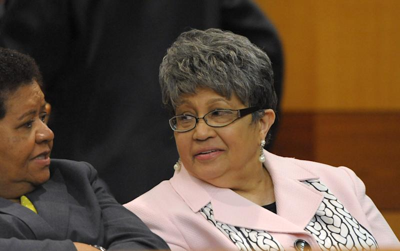 Former Atlanta Public Schools Superintendent Beverly Hall, right, waits for motions at a Fulton County Superior Court hearing for several dozen Atlanta Public Schools educators facing charges alleging a conspiracy of cheating on the CRCT standardized tests in Atlanta, Friday, May 3, 2013. (AP Photo/David Tulis)