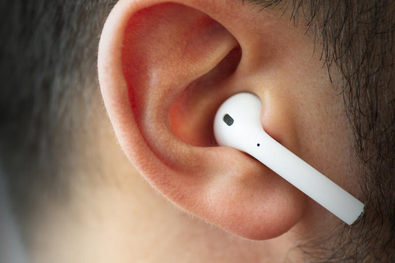 Izmir, Turkey - July 12, 2019: Close up shot of the one of Apple brand airpods on a caucasian white males ear.