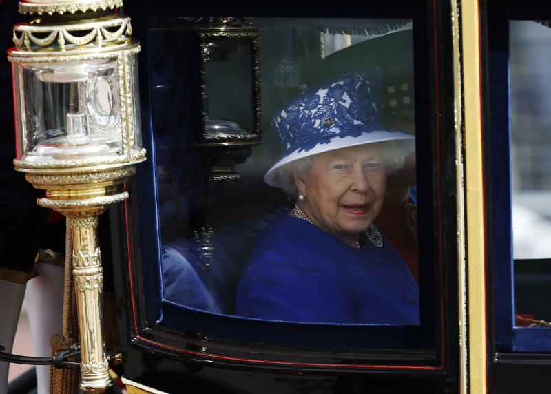 "Britain's Queen Elizabeth II leaves Buckingham Palace in a horse drawn carriage for the Trooping The Colour parade, at the Horse Guards Parade in London, Saturday, June 15, 2013. Queen Elizabeth II is celebrating her birthday with traditional pomp and circumstance. More than 1,000 soldiers, horses and musicians are taking part in the parade known as ""Trooping the Color,"" an annual ceremony (AP Photo/Sang Tan)"