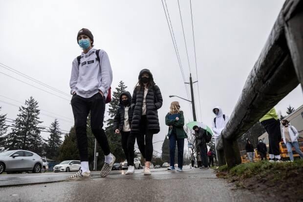 Students are pictured during a break at Earl Marriott Secondary School in Surrey, B.C. As of Wednesday morning, there were just over 50 active COVID-19 exposures listed in the Surrey school district. (Ben Nelms/CBC - image credit)