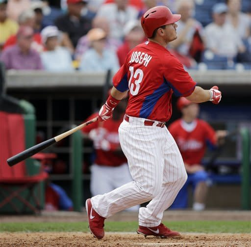 Philadelphia Phillies' Tommy Joseph follows through on his two-run home run off New York Yankees' Zach Nuding during the seventh inning of a spring training exhibition baseball game, Tuesday, Feb. 26, 2013, in Clearwater, Fla. Philadelphia won 4-3. (AP Photo/Matt Slocum)