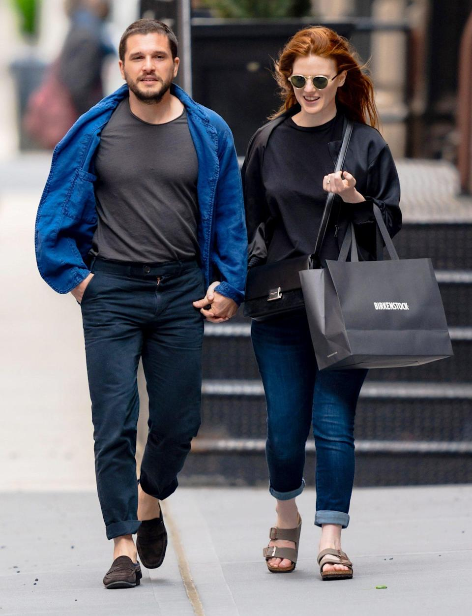 <p>Kit Harington and Rose Leslie hold hands while out shopping in N.Y.C. on Friday. </p>
