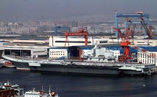 China's first aircraft carrier, the Liaoning, is berthed at the northeastern port of Dalian in September