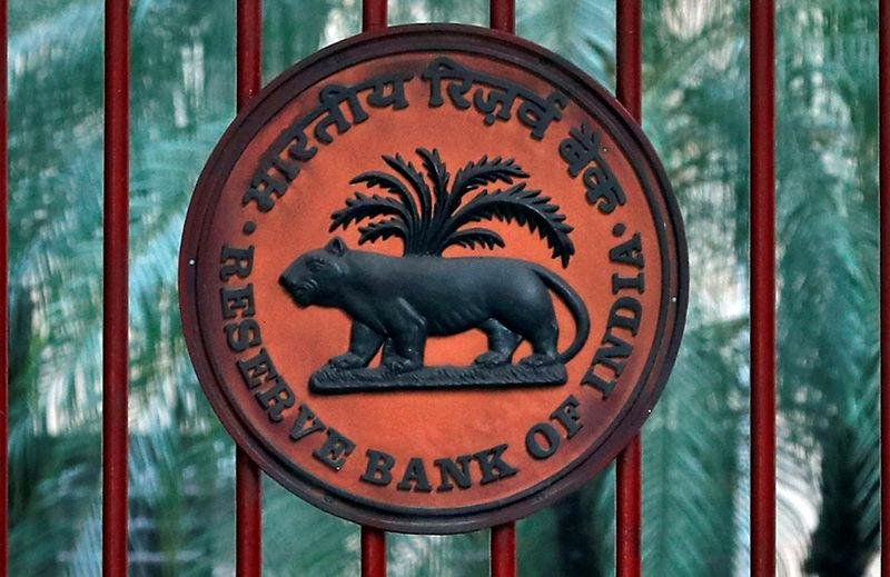 Reserve Bank of India logo is seen at the gate of its office in New Delhi