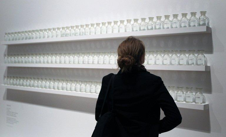 """A visitor looks at the work """" We are all water"""" of Yoko Ono during the press visit of her exhibition """"half-a-wind show"""" at the Schirn Kunsthalle in Frankfurt am Main on February 14, 2013. The largest-ever retrospective of works of Yoko Ono, once described by her late husband John Lennon as """"the most famous unknown artist in the world"""", opened in Frankfurt's Schirn Kunsthalle"""