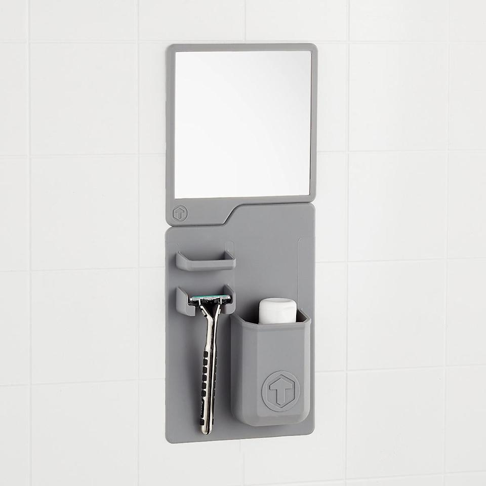 """<p>We love that this <a href=""""https://www.popsugar.com/buy/Tooletries-Toothbrush-amp-Razor-Holder-Mirror-476416?p_name=Tooletries%20Toothbrush%20%26amp%3B%20Razor%20Holder%20and%20Mirror&retailer=containerstore.com&pid=476416&price=13&evar1=casa%3Auk&evar9=46463978&evar98=https%3A%2F%2Fwww.popsugar.com%2Fhome%2Fphoto-gallery%2F46463978%2Fimage%2F46464020%2FTooletries-Toothbrush-Razor-Holder-Mirror&list1=shopping%2Corganizing%2Corganization%2Cbathrooms%2Chome%20organization%2Chome%20shopping&prop13=api&pdata=1"""" rel=""""nofollow"""" data-shoppable-link=""""1"""" target=""""_blank"""" class=""""ga-track"""" data-ga-category=""""Related"""" data-ga-label=""""https://www.containerstore.com/s/bath/shower-and-bathtub/tooletries-toothbrush-and-razor-holder-and-mirror/12d?productId=11007799"""" data-ga-action=""""In-Line Links"""">Tooletries Toothbrush &amp; Razor Holder and Mirror</a> ($13-$15) attaches inside your shower.</p>"""