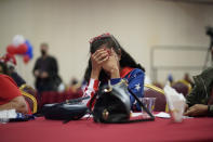 President Donald Trump supporter Loretta Oakes reacts while watching returns in favor of Democratic presidential candidate former Vice President Joe Biden, at a Republican election-night watch party, Tuesday, Nov. 3, 2020, in Las Vegas. (AP Photo/John Locher)