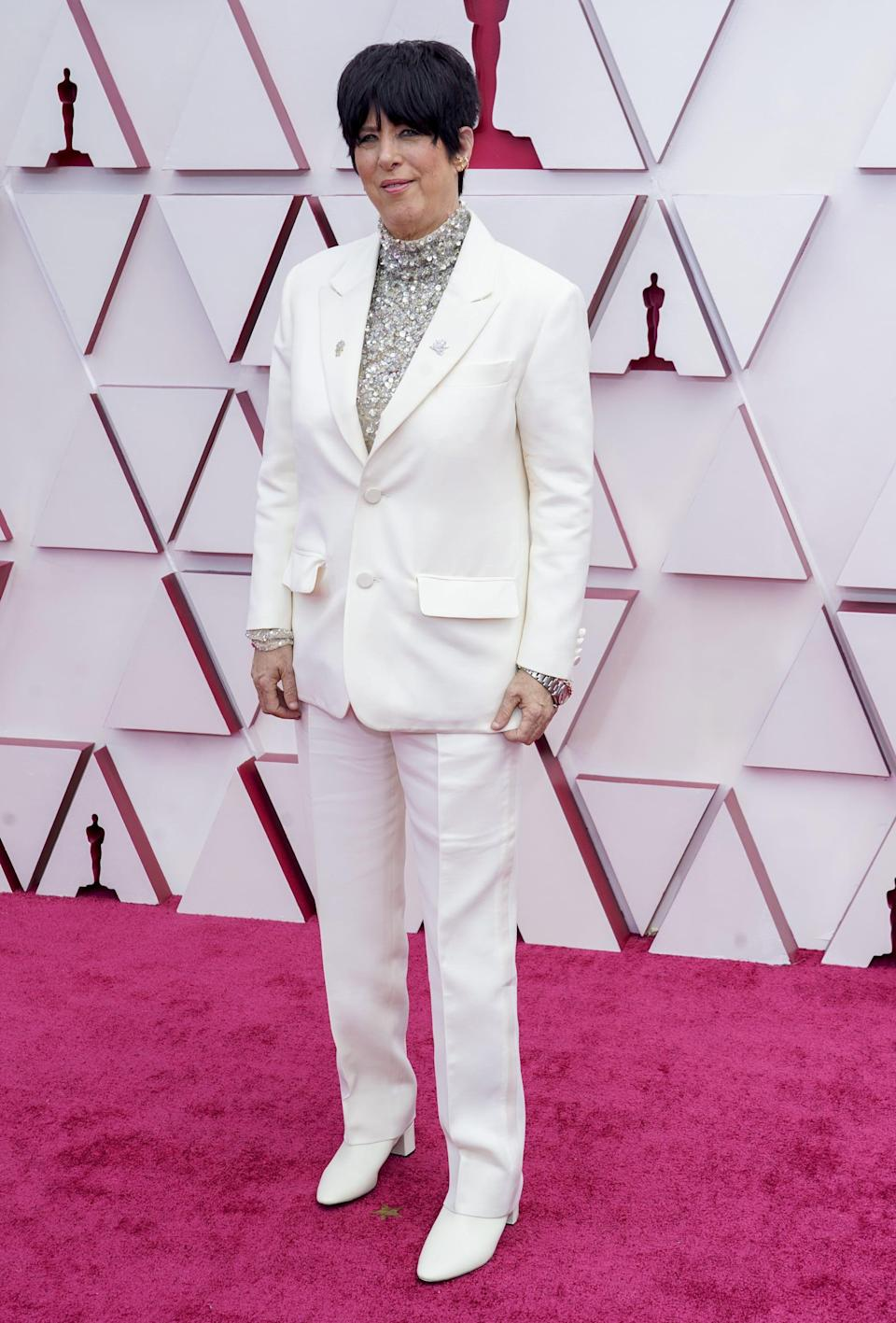 <p>Wearing a Valentino suit.</p>