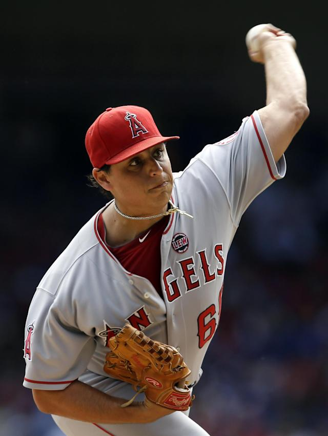 FILE - In this Sept. 29, 2013, file photo, Los Angeles Angels starting pitcher Jason Vargas delivers to the Texas Rangers in the first inning of a baseball game in Arlington, Texas. The Kansas City Royals have agreed to a four-year contract with left-hander Vargas in an attempt to fill the void in their rotation created by Ervin Santana's free agency. (AP Photo/Tony Gutierrez. File)