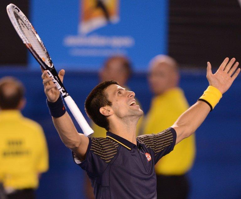 Serbia's Novak Djokovic celebrates after beating Andy Murray to win the Australian Open in Melbourne on January 27, 2013