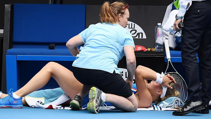 Dayana Yastremska, pictured here receives medical treatment during her clash Caroline Wozniacki at the Australian Open.