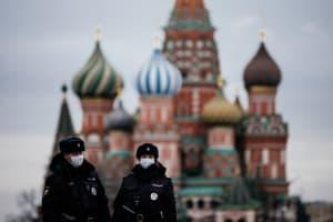Police officers wear masks in Moscow.