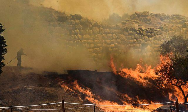Wildfires ravage parts of Greece, Spain and Italy - forcing thousands to evacuate their homes