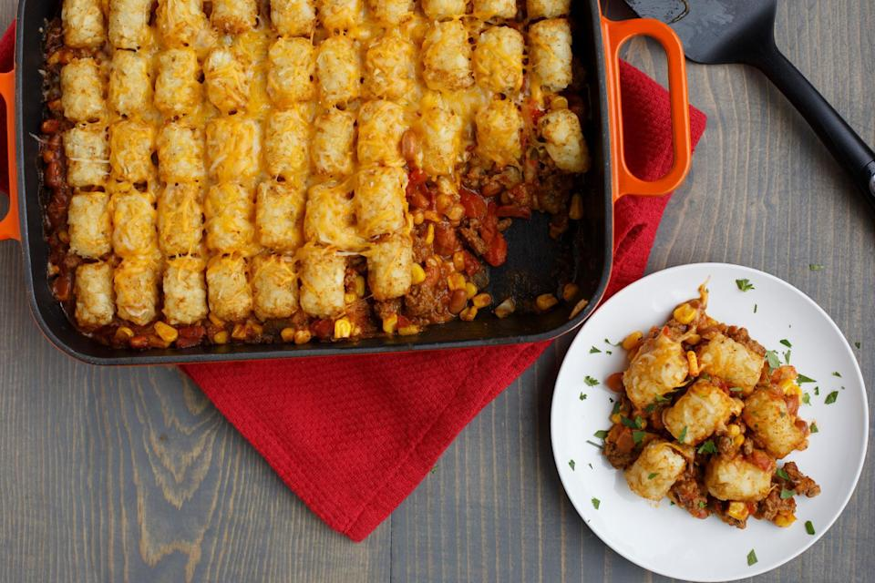 """<p>In Minnesota, no church potluck is complete without hotdish. A hotdish isn't specific, but you know this casserole full of meat and veggies when you see it. How will you instantly recognize this <a href=""""https://www.thedailymeal.com/eat/regional-dishes-you-ve-never-heard?referrer=yahoo&category=beauty_food&include_utm=1&utm_medium=referral&utm_source=yahoo&utm_campaign=feed"""" rel=""""nofollow noopener"""" target=""""_blank"""" data-ylk=""""slk:favorite regional dish"""" class=""""link rapid-noclick-resp"""">favorite regional dish</a>? Because this hotdish, like the best ones, is topped with tater tots.</p> <p><a href=""""https://www.thedailymeal.com/recipes/taco-tater-topped-casserole-recipe?referrer=yahoo&category=beauty_food&include_utm=1&utm_medium=referral&utm_source=yahoo&utm_campaign=feed"""" rel=""""nofollow noopener"""" target=""""_blank"""" data-ylk=""""slk:For the Taco Tater-Topped Hotdish recipe, click here."""" class=""""link rapid-noclick-resp"""">For the Taco Tater-Topped Hotdish recipe, click here.</a></p>"""