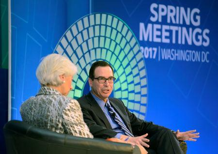 """U.S. Treasury Secretary Steven Mnuchin (R) makes remarks as he and IMF Managing Director Christine Lagarde hold """"A Conversation on the US Economy"""", as part of the IMF and World Bank's 2017 Annual Spring Meetings, in Washington, U.S., April 22, 2017.   REUTERS/Mike Theiler"""