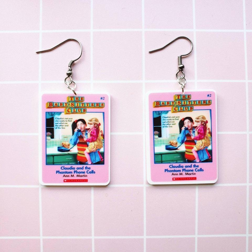 <p>Relive the days of binge-reading <strong>The Baby-Sitters Club</strong> books with these adorable <span><strong>The Baby-Sitters Club</strong> Earrings</span> ($12). </p>