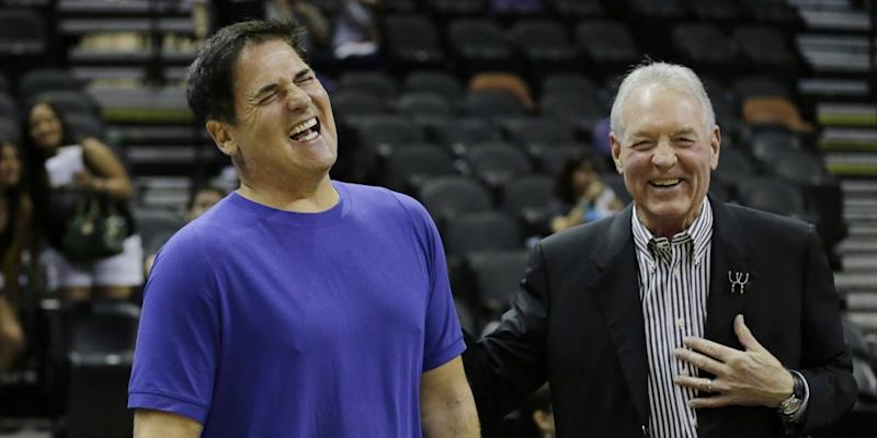 Dallas Mavericks owner Mark Cuban, left, and San Antonio Spurs owner Peter Holt, right, before a recent playoff game.