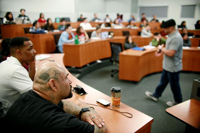 Martin Leyva and Tim Jackson listen to a class discussion on Thursday, April 12, 2018 at Cal State San Marcos in San Marcos, California. Higher education, Leyva said, helped him understand his own story within the nation's larger socio-political framework. (Photo: Sandy Huffaker for Yahoo News)