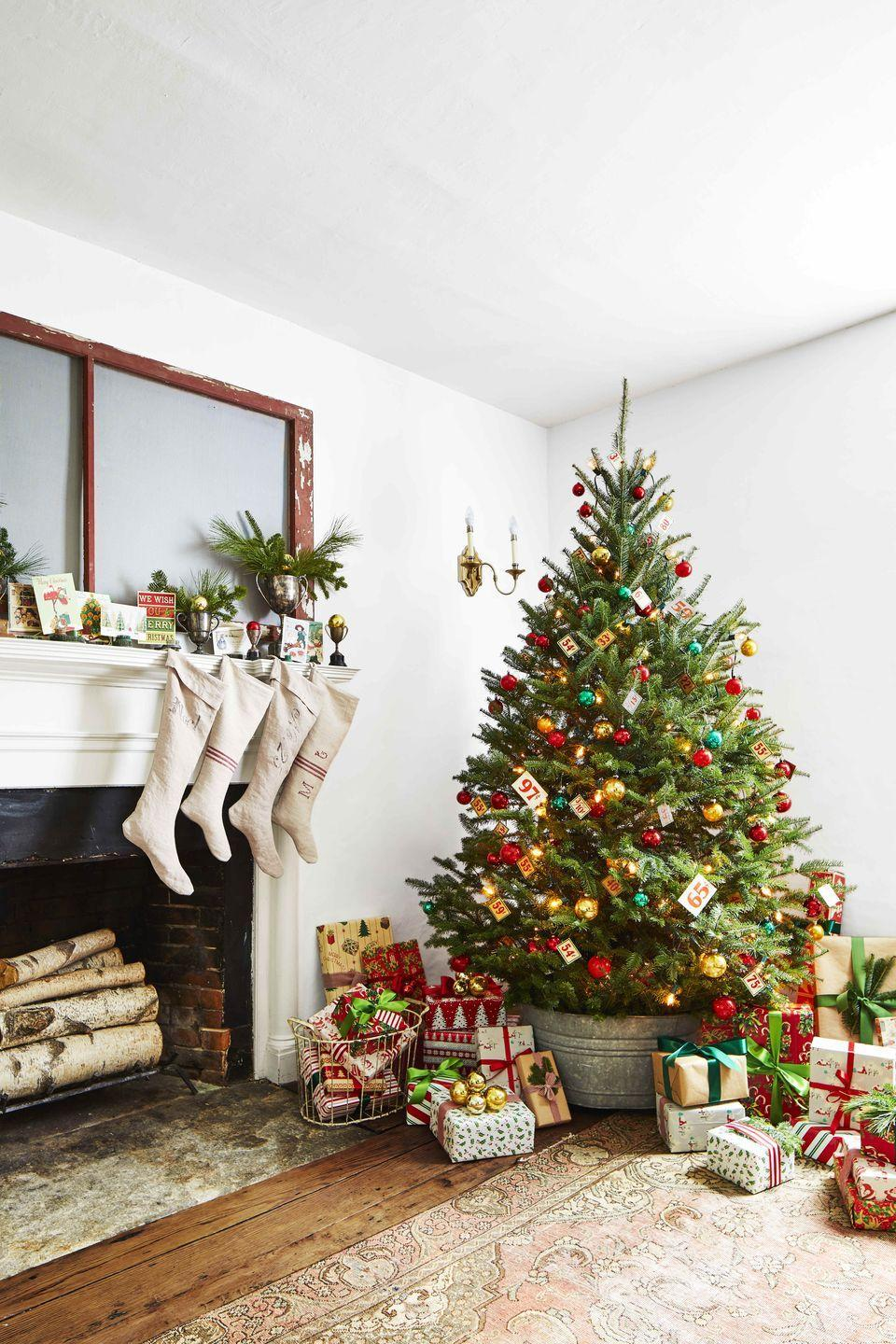 "<p>An oversize galvanized bucket becomes the container for a beautifully fluffy Christmas tree in this 208-year-old Connecticut farmhouse. It also pairs perfectly with the antique grain sack stockings hung from the original fireplace.</p><p><a class=""link rapid-noclick-resp"" href=""https://www.amazon.com/Behrens-105LFT-Gallon-Dipped-Silver/dp/B06VX29TXZ/ref=sr_1_37?tag=syn-yahoo-20&ascsubtag=%5Bartid%7C10050.g.28746492%5Bsrc%7Cyahoo-us"" rel=""nofollow noopener"" target=""_blank"" data-ylk=""slk:SHOP GALVANIZED BUCKETS"">SHOP GALVANIZED BUCKETS</a></p>"