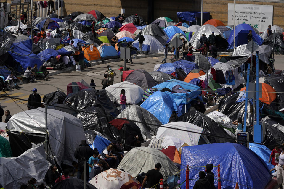 A makeshift camp of migrants sits at the border port of entry leading to the United States, Wednesday, March 17, 2021, in Tijuana, Mexico. The migrant camp shows how confusion has undercut the message from U.S. President Joe Biden that it's not the time to come to the United States. Badly misinformed, some 1,500 migrants who set up tents across the border from San Diego harbor false hope that Biden will open entry briefly and without notice. (AP Photo/Gregory Bull)