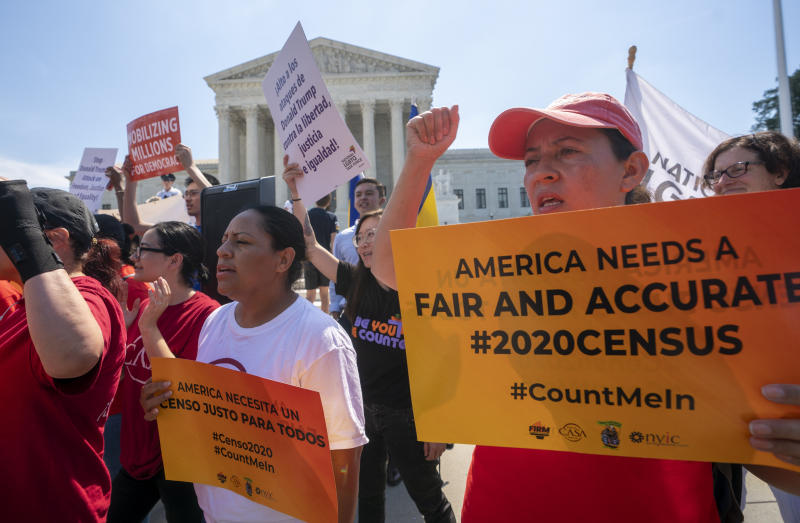 FILE - In this June 27, 2019, file photo, demonstrators gather at the Supreme Court as the justices finish the term with key decisions on gerrymandering and a census case involving an attempt by the Trump administration to ask everyone about their citizenship status in the 2020 census, on Capitol Hill in Washington.  Worried about internet trolls and foreign powers spreading false news, census officials are preparing to battle misinformation campaigns for the first time in the bureau's 230-year history. (AP Photo/J. Scott Applewhite, File)