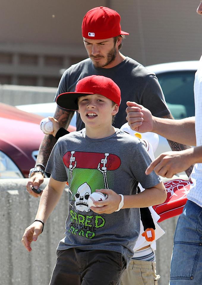 "The Beckham and Ramsay boys were all decked out in Angels baseball gear -- clearly showing their love for their newly-adopted country's national pastime. Skippy/<a href=""http://www.infdaily.com"" target=""new"">INFDaily.com</a> - August 29, 2010"