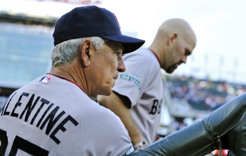 FILE - In this April 23, 2012, file photo, Boston Red Sox manager Bobby Valentine, left, and Kevin Youkilis watch from the dugout during a baseball game against the Minnesota Twins in Minneapolis. The Red Sox fired Valentine on Thursday, Oct. 4, 2012, after one season in which he failed to bring order to a clubhouse that disintegrated during the 2011 pennant race. (AP Photo/Jim Mone, File)