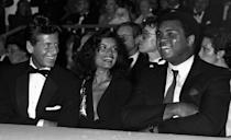 <p>One year after his final fight, 40-year-old Ali sat front row at a Valentino fashion show next to Bianca Jagger and Calvin Klein. </p>