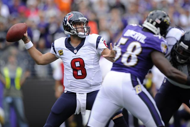 Houston Texans quarterback Matt Schaub (8) throws to a receiver as he is pressured by Baltimore Ravens outside linebacker Elvis Dumervil (58) in the first half of an NFL football game Sunday, Sept. 22, 2013, in Baltimore. (AP Photo/Nick Wass)