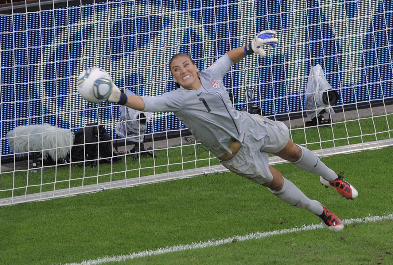 United States goalkeeper Hope Solo deflects a penalty shot during the quarterfinal match between Brazil and the United States at the Womenís Soccer World Cup in Dresden, Germany, Sunday, July 10, 2011. (AP Photo/Jens Meyer)