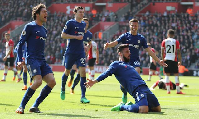 Olivier Giroud celebrates on his knees as his team-mates join him after putting Chelsea 3-2 ahead at Southampton.