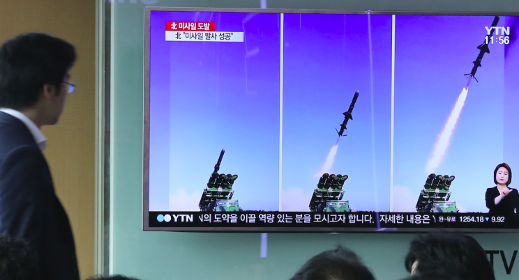 Photos of a recent North Korean missile test appeared on South Korean TV (Picture: Rex)