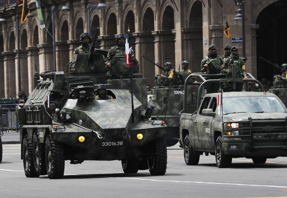 Military vehicles drive during the annual Independence Day military parade in Mexico City's main square of the capital, the Zócalo, Wednesday, Sept. 16, 2020. Mexico celebrates the anniversary of its independence uprising of 1810. ( AP Photo/Marco Ugarte)