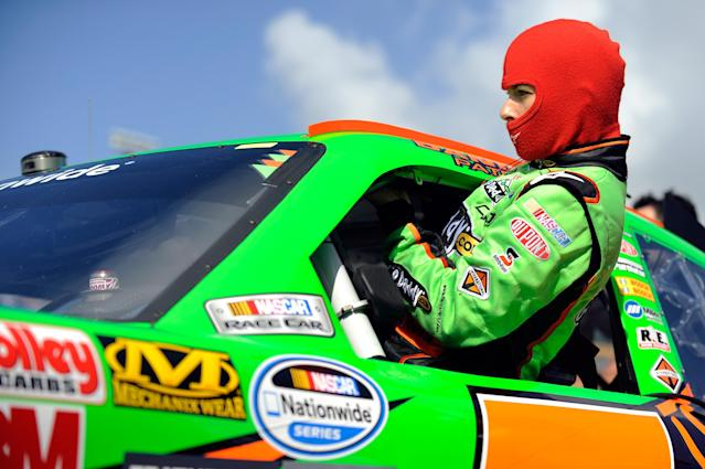 HOMESTEAD, FL - NOVEMBER 19: Danica Patrick, driver of the #7 GoDaddy.com Chevrolet, climbs in her car on the grid during qualifying for the NASCAR Nationwide Series Ford 300 at Homestead-Miami Speedway on November 19, 2011 in Homestead, Florida. (Photo by Jared C. Tilton/Getty Images)