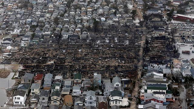 This aerial photo shows burned-out homes in the Breezy Point section of the Queens borough New York after a fire on Oct. 30, 2012, where the tiny beachfront neighborhood told to evacuate before Sandy hit New York burned down as it was inundated by floodwaters, transforming a quaint corner of the Rockaways into a smoke-filled debris field. Mike Groll/AP Photo