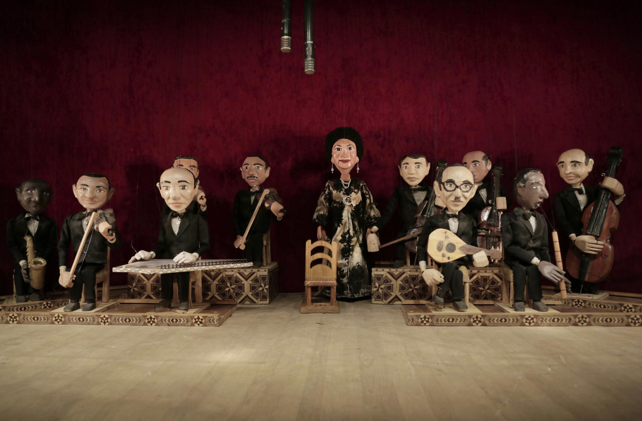 In this May 3, 2018 photo, marionettes of Umm Kalthoum, the most famed singer of classical Arabic music, and her band, made by Egyptian artist Mohamed Fawzi Bakkar, perform at the El Sawy Cultural Center, in Cairo, Egypt. Bakkar designs and builds marionettes from scratch, hoping to revive a traditional art. The 32-year-old spends hours or even days designing puppets inspired by Egyptian life -- farmers, street vendors, butchers and the occasional celebrity. (AP Photo/Nariman El-Mofty)