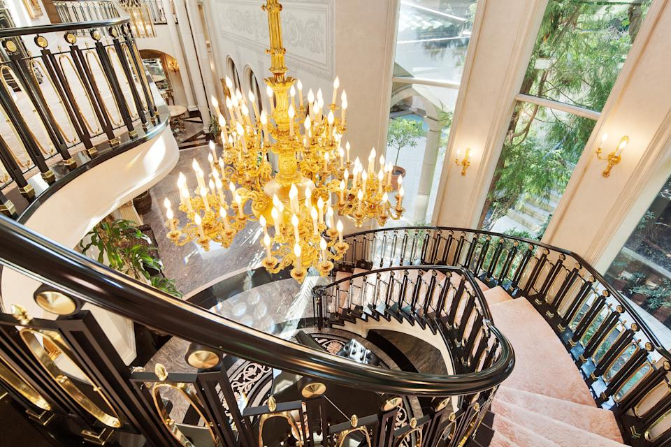 <p>The porte-cochère entry opens into two main gallery halls with seating for up to 100 guests for private concerts and events. A sweeping grand staircase is lit by an Italian Ormulu chandelier.</p> <p>(Sotheby's International Realty Canada)</p>