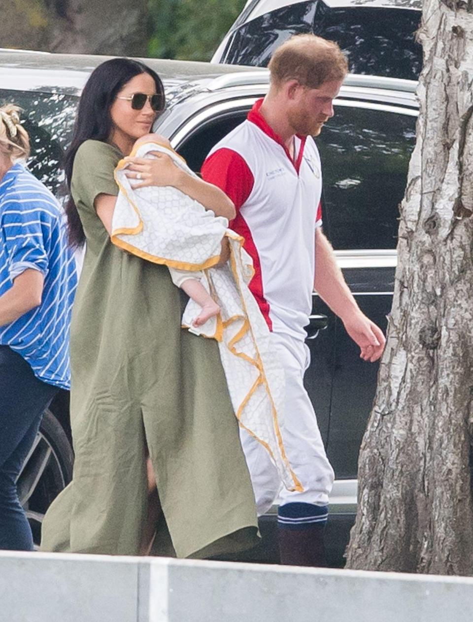 <p>Harry walks with Meghan and Archie after playing in a polo match in Wokingham, England. </p>
