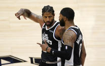 Los Angeles Clippers guard Paul George, left, celebrates with forward Marcus Morris Sr. during a timeout in the second half of Game 3 of a second-round NBA basketball playoff series against the Utah Jazz Saturday, June 12, 2021, in Los Angeles. (AP Photo/Mark J. Terrill)