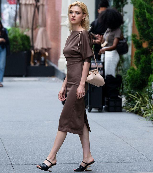 """<p>The actor wore a brown satin midi dress teamed with a Fendi AW21 beige bag for an outing out in NYC. </p><p><a href=""""https://www.instagram.com/p/CRWyI0wLTCf/"""" rel=""""nofollow noopener"""" target=""""_blank"""" data-ylk=""""slk:See the original post on Instagram"""" class=""""link rapid-noclick-resp"""">See the original post on Instagram</a></p>"""