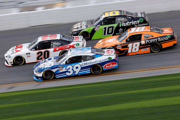 Harrison Burton, driver of the #20 DEX Imaging Toyota, Ryan Sieg, driver of the #39 CMR Construction and Roofing Ford, Daniel Hemric, driver of the #18 Poppy Bank Toyota, Jeb Burton, driver of the #10 Nutrien Ag Solutions Chevrolet, race during the NASCAR Xfinity Series Beef. It's What's For Dinner. 300 at Daytona International Speedway on February 13, 2021 in Daytona Beach, Fla.